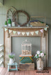 rustic mantel with wooden tool caddy and spring decor
