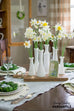 rustic wood cheese board with rope handle and milk glass vases