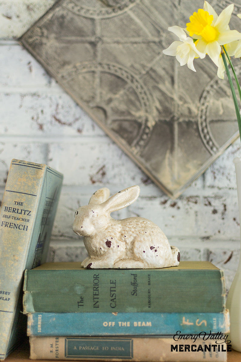 distressed white cast iron bunny statue