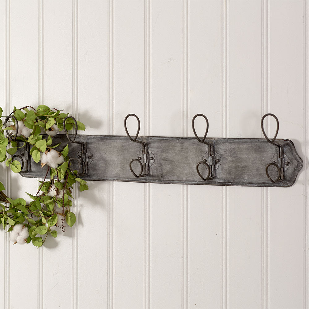 aged metal wall rack with hooks
