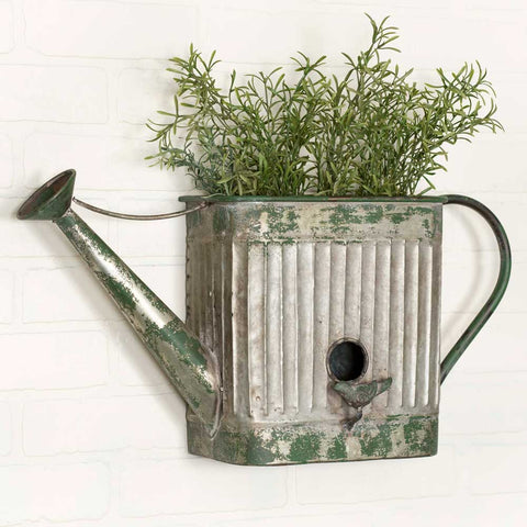 metal watering can birdhouse planter