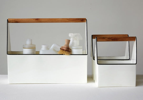 white enamelware caddy with wood handle