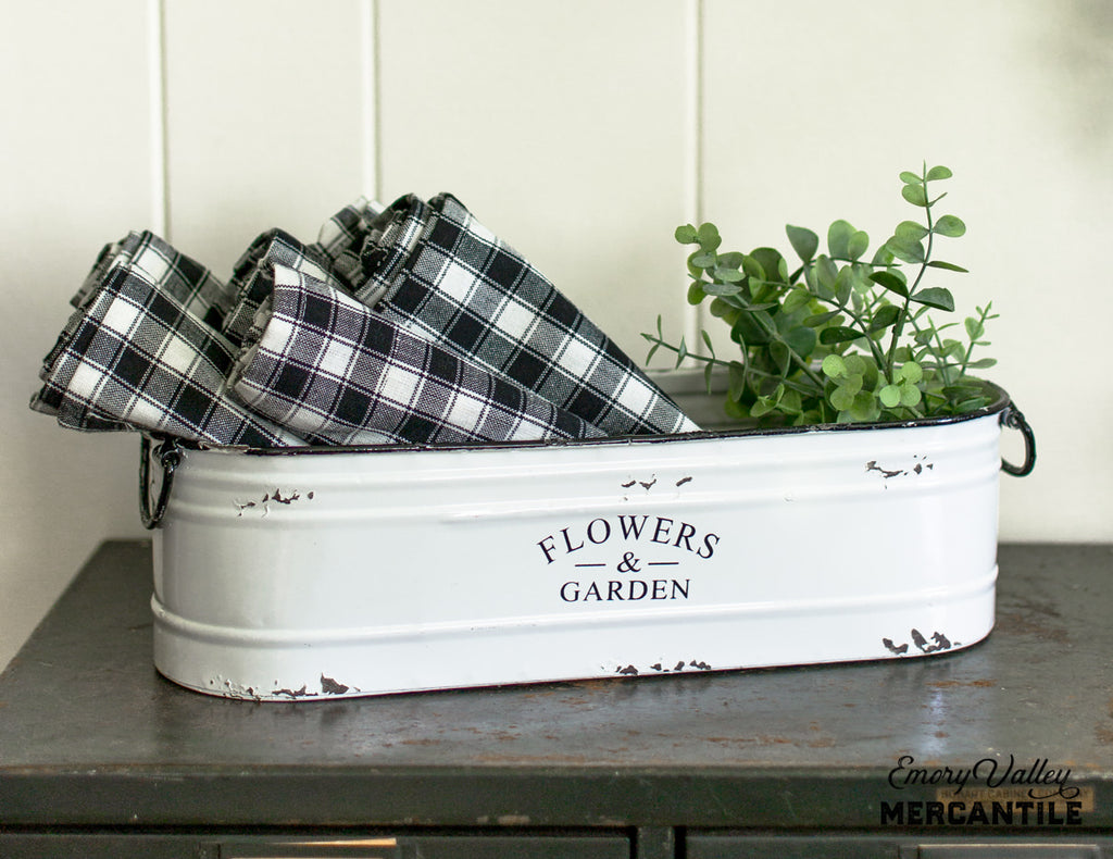 white enamel flowers and garden bin