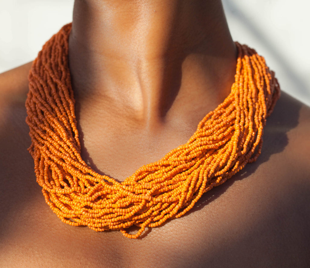 Hand crafted, orange beaded , statement necklace, glass beading and hypoallergenic