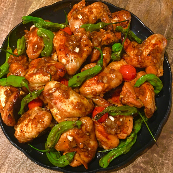 Grilled Chicken Wings with Tomatoes and Shishito Peppers
