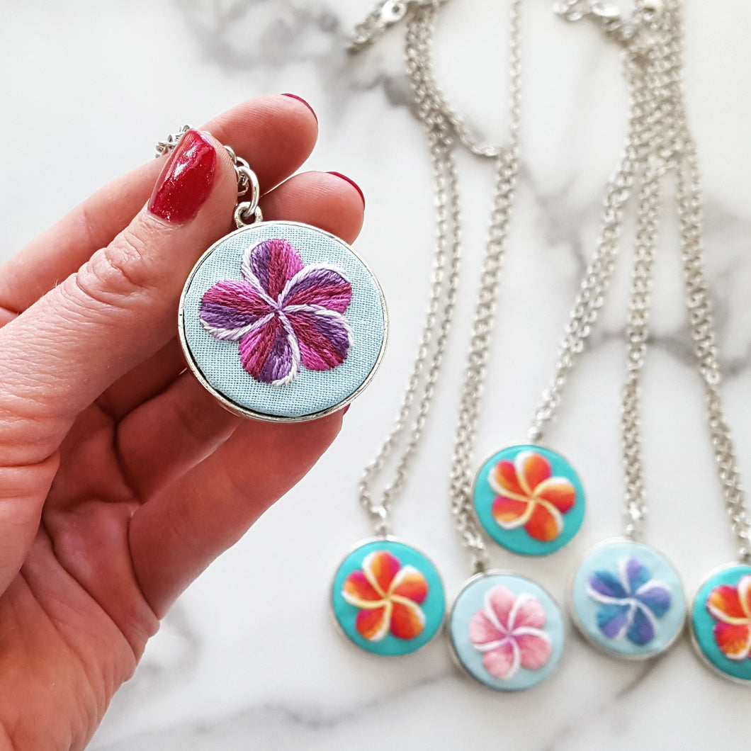 Hand embroidered plumeria necklaces, set in Silver