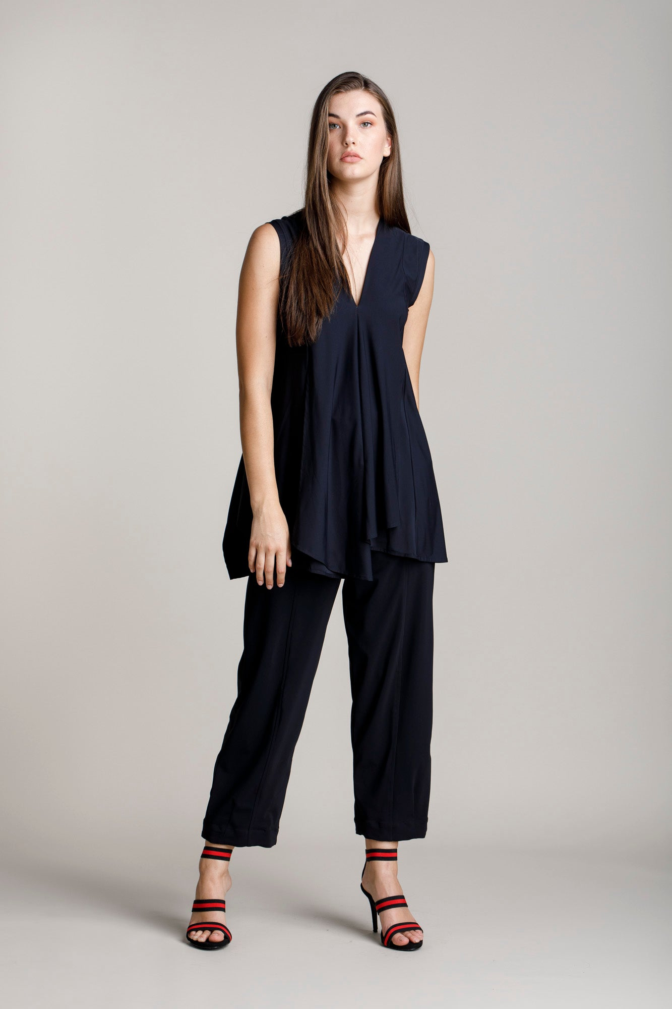 Black jersey hip pocket pant with a wide leg and cropped length, Australian made