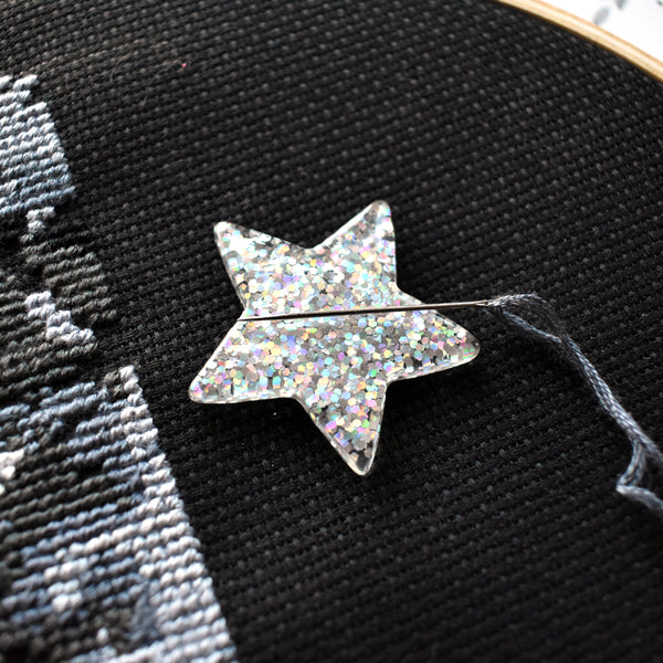 Holographic Star Needle Minder