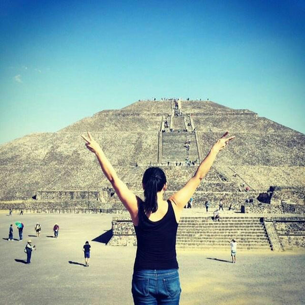 Kimmi posing in a black tanktop with a pyramid in the background