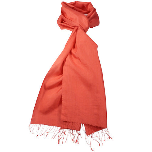 Coral silk scarf tied in a simple knot