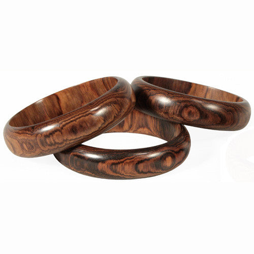 Three wide rosewood bangles
