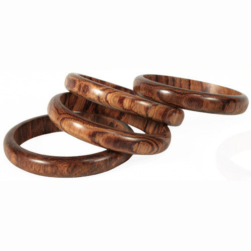Four narrow rosewood bangles