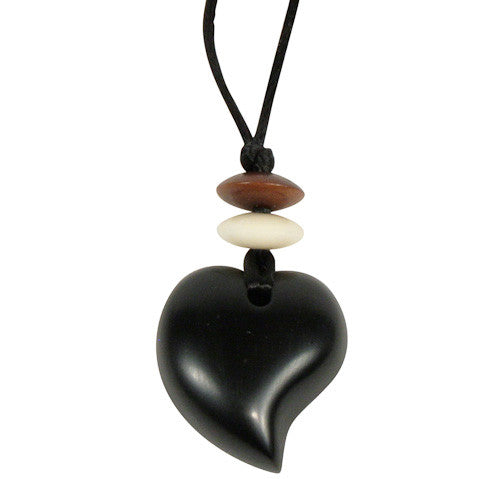 Handmade raindrop-shaped piece of coal on a string with tagua and wooden beads