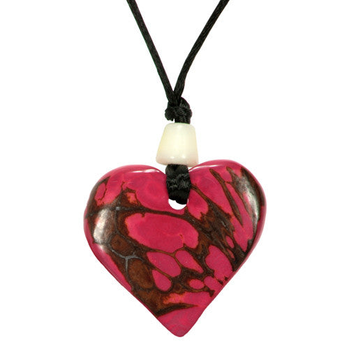 Pink Handmade Heart-Shaped Tagua Pendant on a Black Pendant