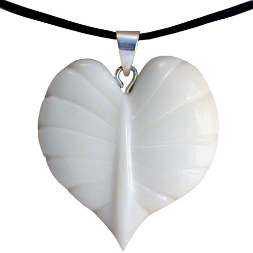 White leaf-shaped hand-carved tagua nut