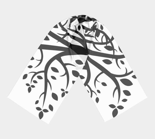 Branches on a folded white scarf