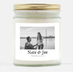 Engagement candle with couple's names, date, and photo.