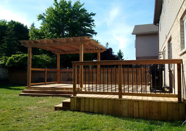 Iron deck railing with arbour pergola Campbell Fence and Deck