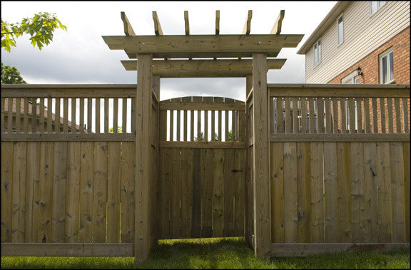 Wood fence with pergola arbour gate in Cambridge by Campbell Fence