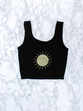 black crop top with gold sun design