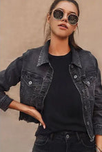 Distressed black denim jacket with raw hem