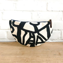 Erin Flett canvas half moon clutch with abstract black design