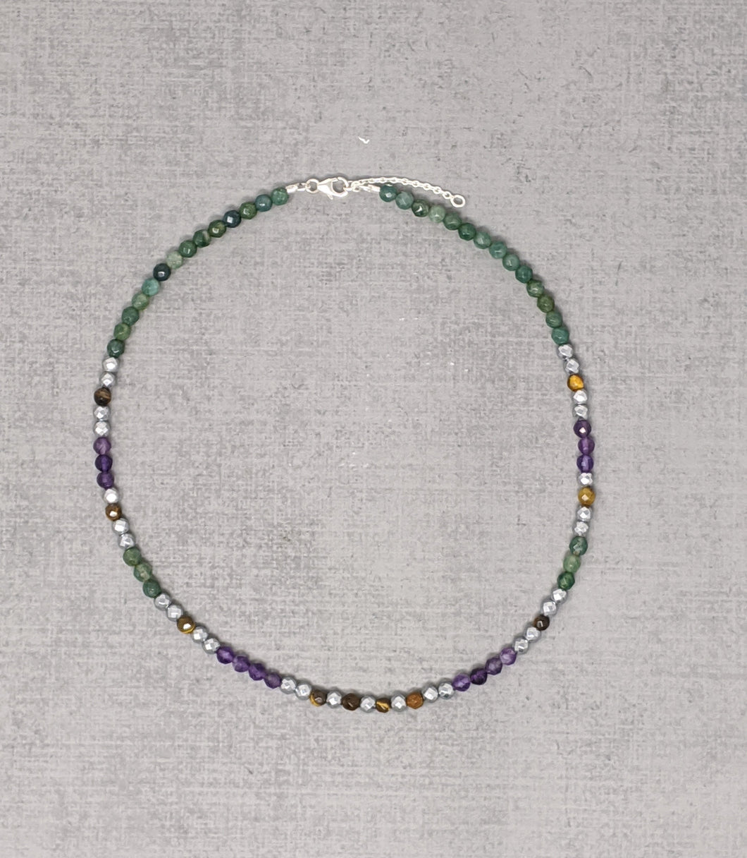 sterling silver necklace with faceted moss agate, amethyst, tiger's eye, and hematite stones.