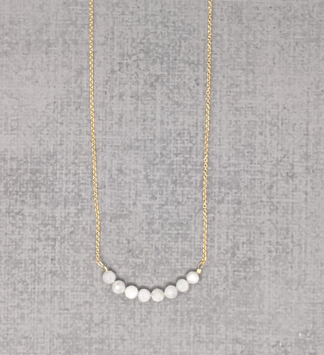 Yellow gold moonstone curve necklace