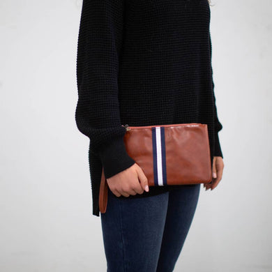 navy and white stripe brown leather clutch