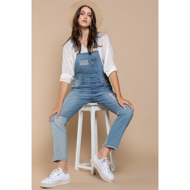patched denim overalls
