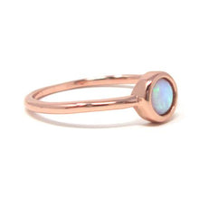 Rose gold round opal ring