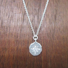 Sterling silver starburst pendant necklace with cz