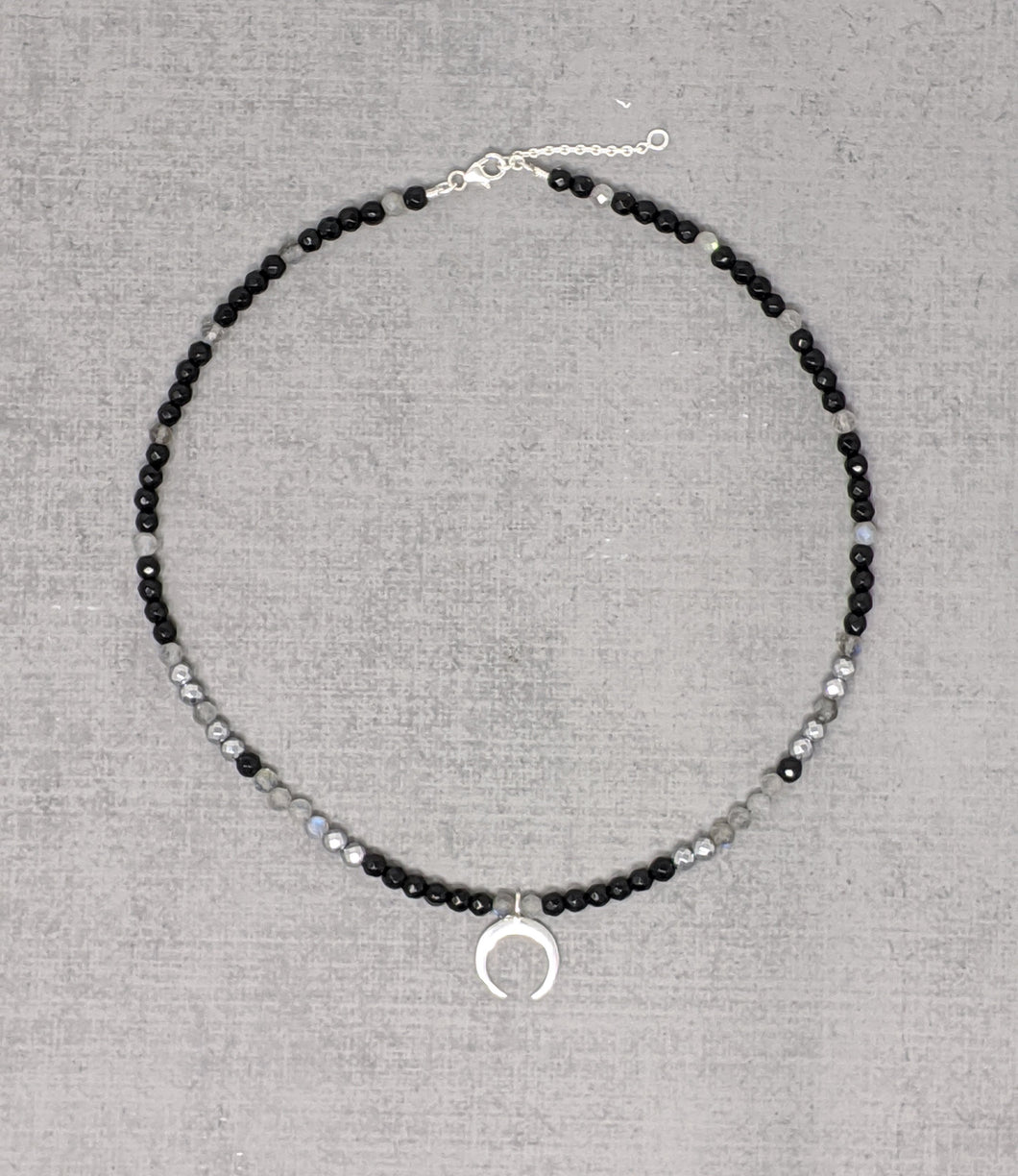 Sterling silver necklace with faceted onyx, labradorite, hematite stones and crescent moon pendant