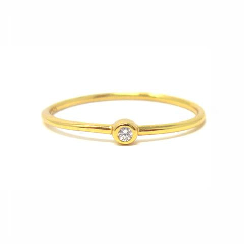 Yellow gold solitaire bezel ring with cubic zirconia