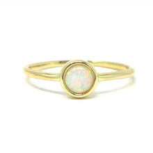 Yellow gold round opal ring