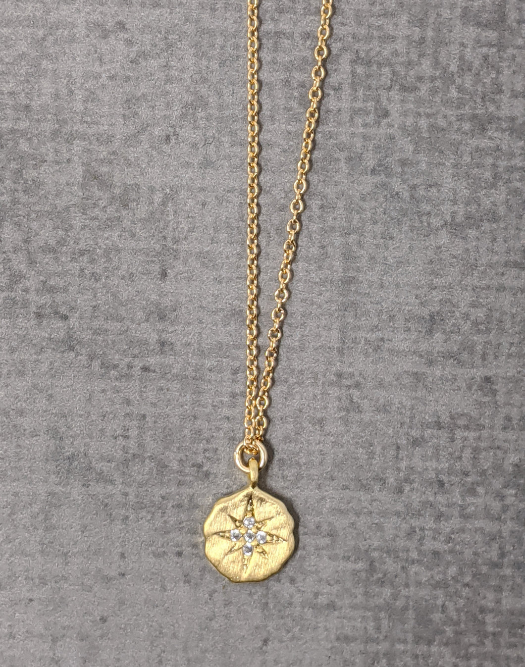 Yellow gold starburst necklace with CZ