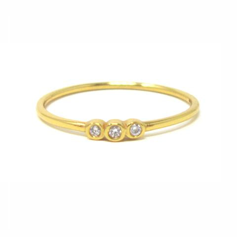 yellow gold three stone ring with cubic zirconia