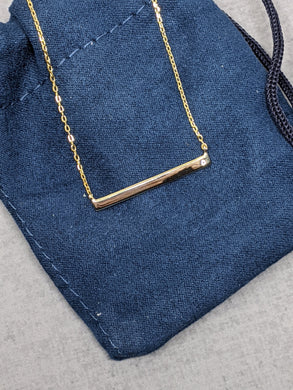 yellow gold bar necklace with tiny cz