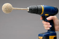GourdMaster Easy Cleaner Ball Attached to an Electric Drill