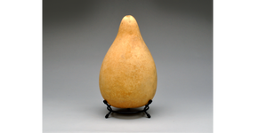 A Medium Size gourd fits in the 5-inch Metal Gourd Stand