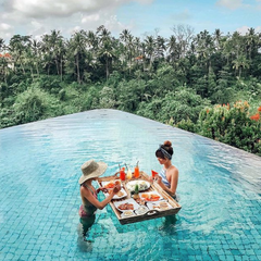 Poolside in bali in your favorite bikini with a floating breakfast