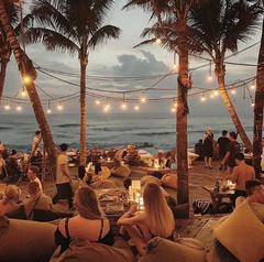 Beachside in a Bikini in Bali at an outdoor beach bar