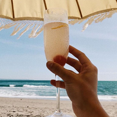 Drink champagne by the beach in bali at one of their famous beach clubs