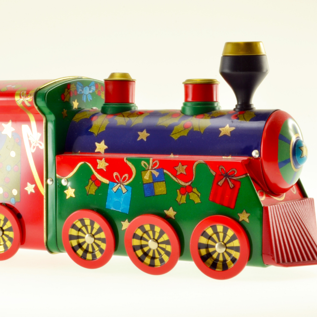 Train shaped tin with moving wheels