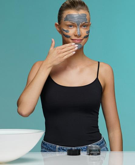 revivalist charcoal detox mask on face
