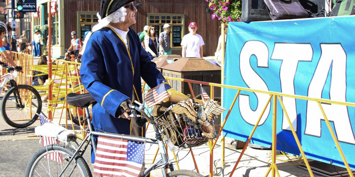 Man in American patriotic clothing on a bicycle