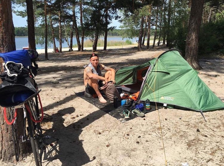 Ben Flanagan camping on a lake
