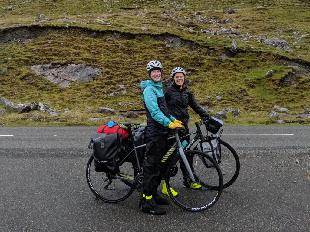 Fiona and Lucy cycling in rainy Scotland mountains