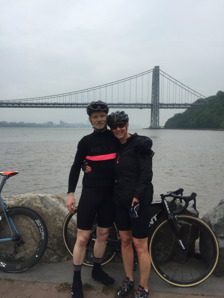 Jim and his wife in front of a bridge