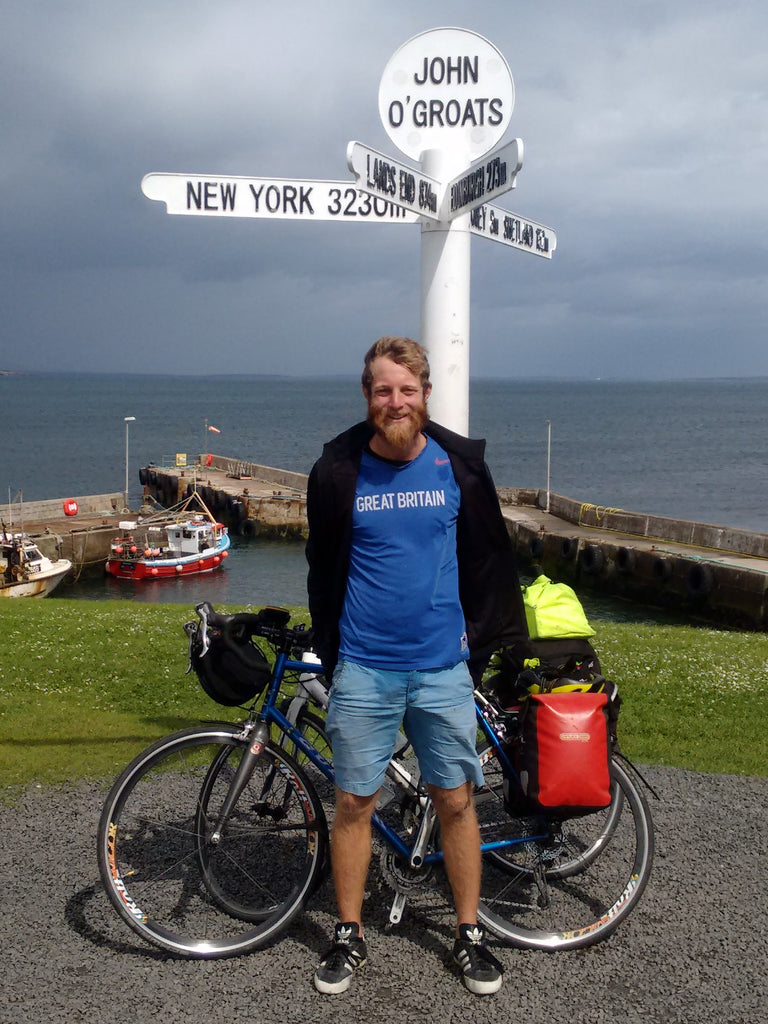 Sam in front of John O'Groats sign
